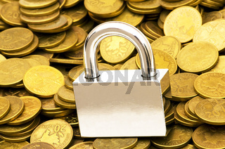 Concept of financial security with lock and coins