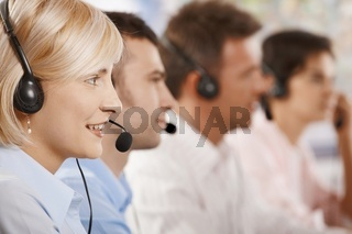 Customer service operators in a row
