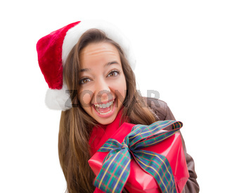 Girl Wearing A Christmas Santa Hat with Bow Wrapped Gift Iisolated on White.