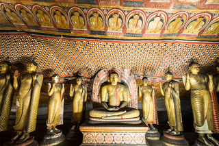 Buddhas statues and religious carving at Golden Temple. Dambulla, Sri Lanka