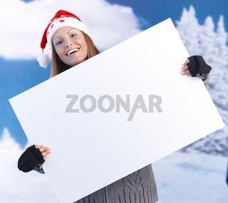 Happy girl in santa hat holding huge letter