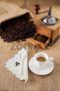 Coffee with mill and beans on jute