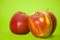 three red juicy apples