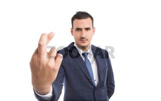 Entrepreneur or real estate agent making bad luck gesture