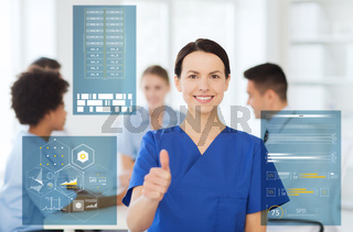 happy smiling doctor showing thumbs up at hospital