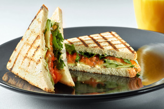 sandwich with salmon and orange juice for breakfast