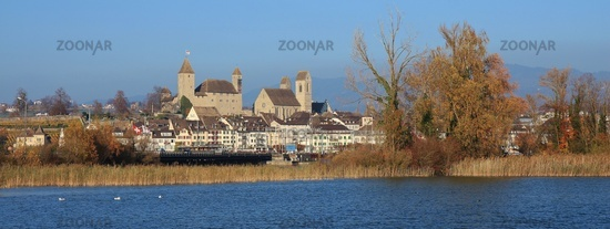 Medieval castle and church in Rapperswil, St Gallen canton, Switzerland. Blue lake Obersee. Autumn scene.