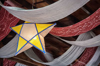 Decorations on the ceiling from fabric in the form of stars