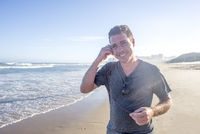 Man on Beach with Earphones