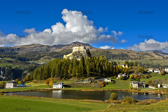 Tarasp Castle rising above lake Taraspsee, Tarasp, Lower Engadin, Graubünden, Grisons, Switzerland