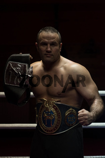 kick boxer with his championship belt