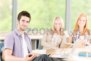 Group of young high school students learning