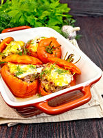 Tomatoes stuffed with rice and meat in brown brazier