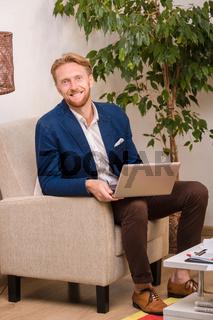 Rich European businessman working at home