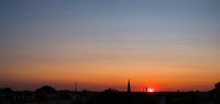 sunset sky over city , colorful sky panorama over rooftops