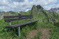 Bench in front of mountain