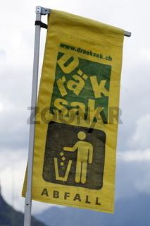 Banner 'Draeksak', Schweizer Bezeichnung fuer ein Abfallgefaess.