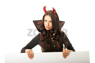 Woman wearing devil clothes holding white empty banner