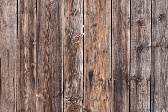 Wooden boards as a rustic wooden fence or wooden wall - background