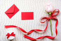 Flower and gift with a message card and letter