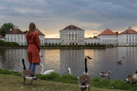 Dramatic post storm sunset scenery of Nymphenburg palace in Munich Germany.
