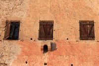 Windows on old medieval tower building