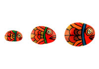 Fish family hand painted peebles isolated in white