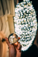 A glass ball in the background of a garland