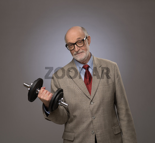Senior man with dumbbell