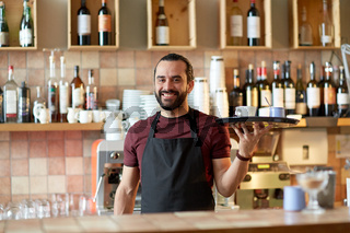 happy man or waiter with coffee and sugar at bar