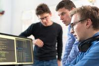 Startup business, software developer working on desktop computer.