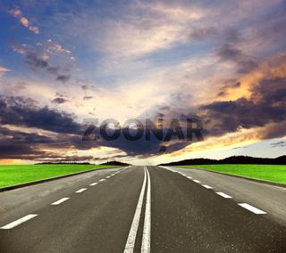 Asphalt road and sunset sky