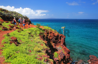 Group of people visiting Rabida Island in Galapagos National Park, Ecuador
