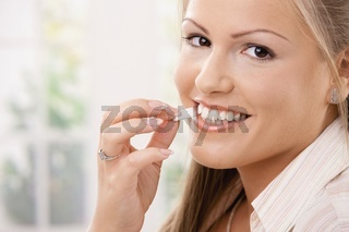 Beautiful woman eating chewing gum