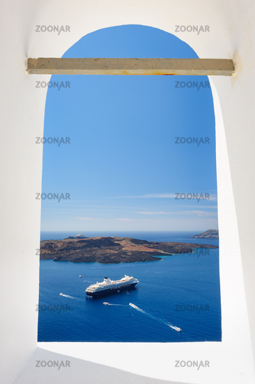 View through church window in Fira to caldera sea, Santorini