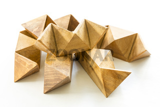Wooden puzzle on white