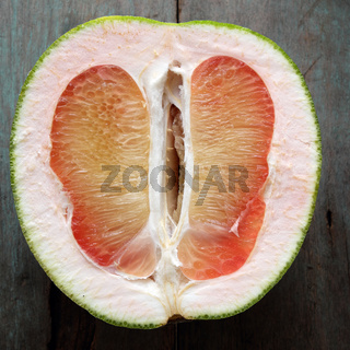 Grapefruit on wood background, tropical fruit