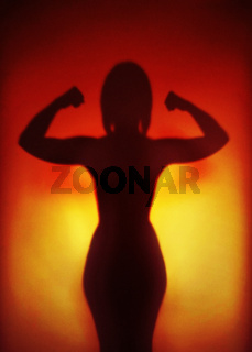 female empowerment concept silhouette of a strong woman flexing muscles