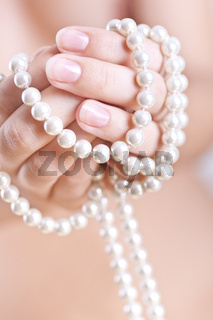 pearls in the women's hands