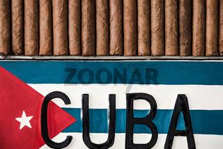 Cuban cigars and cuban flag, top view