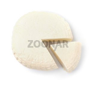 Top view of brined cheese wheel