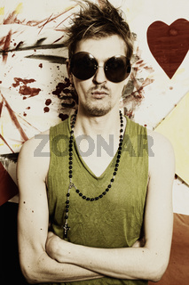 Young punk man wearing sunglasses