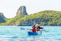 Mother and daughter travel by kayak