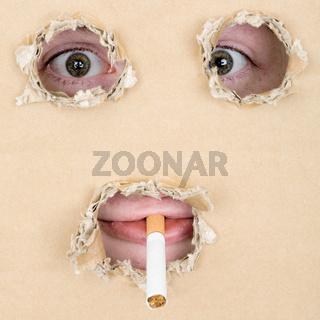 Mug smoking a cigarette