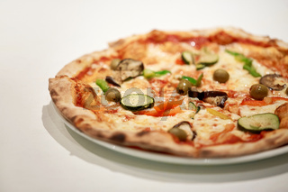 close up of pizza on plate at pizzeria