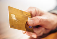 Hand with golden credit card