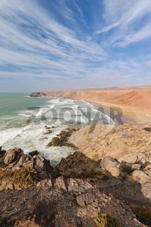 Rough colorful coastline, Atlantic, Morocco