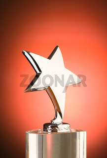 Star award against red gradient background