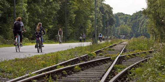 cyclists on rail bike path Nordbahntrasse, Wuppertal, North Rhine-Westphalia, Germany, Europe