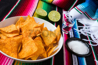 Nachos chips in a bowl tequila lime and salt